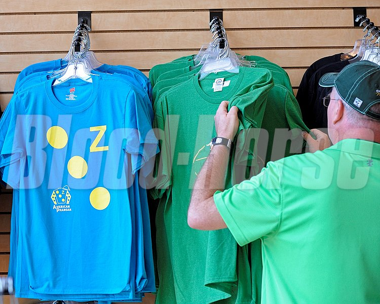 Caption:  Looking over merchandise at Belmont Park including Zayat t-shirt for American Pharoah
