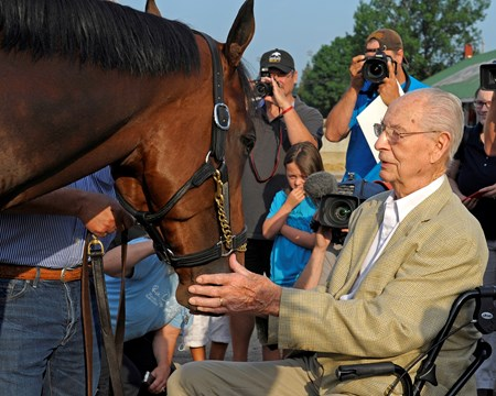 Dr. William McGee, veterinarian and founding partner of Hagyards Equine Medical Institute in Lexington, KY, has seen most of the Triple Crown winners and takes a moment to feed carrots to American Pharoah at Churchill Downs  June 12, 2015.