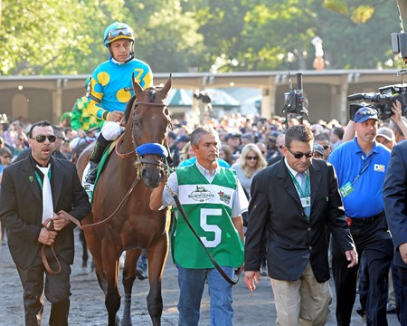Victor Espinoza aboard American Pharoah before the 147th Running of the Belmont Stakes at Belmont Park in New York.