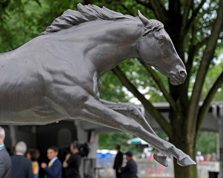 Caption:  Secretariat statue in Belmont paddock with carnations for the Belmont Stakes