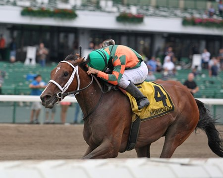 Keep Crossing and jockey Gabriel Saez capture the $70,000 Red Cross Stakes at Monmouth Park.