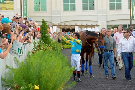 Caption: Victor waves to crowd