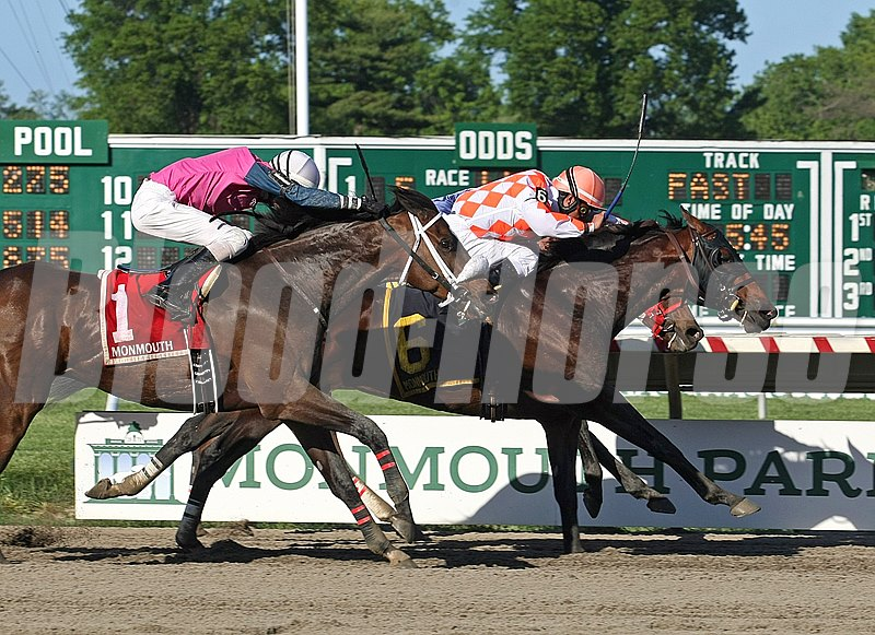 Saucy Don #6 and jockey Abel Castellano Jr. battle down the stretch to win the $60,000 John J. Reilly Handicap at Monmouth Park in Oceanport, New Jersey.