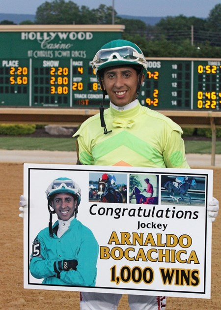 Jockey Arnaldo Bocachica celebrates his 1,000th career victory with a win aboard Answer the Call in the third race at Charles Town on 05-28-15.
