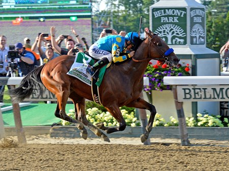 American Pharoah crosses the wire to win the Belmont Stakes sweeping the Triple Crown.