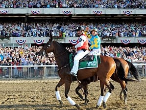 The crowd cheers as American Pharoah returns from winning the Belmont Stakes.