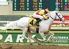 Beautiful Devil, a rare white Thoroughbred, wins at Belterra Park July 4.