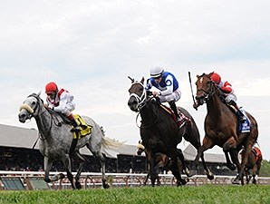Hard Not to Like (left) gets up late to take the Diana Stakes.