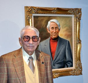 John Nerud at the National Museum of Racing and Hall of Fame in 2011 standing next to his painting. He was inducted in to the Hall of Fame in 1972.