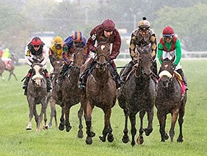 Secret Gesture (center, maroon silks) finished first in the Beverly D., but was disqualified and placed third.