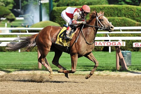 Coup de Grace and jockey Rosie Naprivnik win the Amsterdam Stakes (gr. 2) at Saratoga Race Course on July 26, 2014.