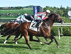Takeover Target rallies late to take the National Museum of Racing Hall of Fame Stakes.
