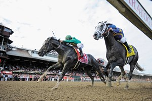 Honor Code caught early leader Liam's Map in the final strides to win the $1.25 million Whitney Stakes (gr. I) at Saratoga Race Course.
