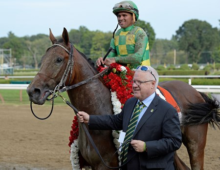 Caption: Jerry Crawford walks Keen Ice into the winner circle. Keen Ice with Javier Castellano wins the Travers (gr. I) at Saratoga on Travers Day, Aug. 29, 2015, at Saratoga in Saratoga Springs, N.Y. Donegal Racing, Jerry Crawford, Romans Racing, Dale Romans, Tammy Fox Travers1  image Anne M. Eberhardt photo