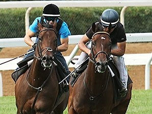 The Great War, left, Green Mask, right, work at Keeneland Sept. 27.