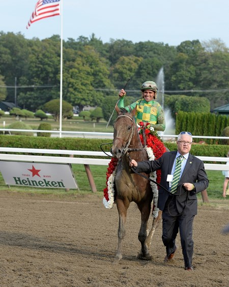 Javier Castellano celebrates aboard Keen Ice after winning the Travers Stakes (gr. I) at Saratoga.