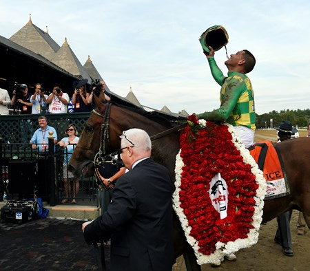 #7 Keen Ice with jockey Javier Castellano, is lead to the winner's circle by Donegal Racing's managing partner Jerry Crawford after his charge won the 146th running of the Travers Stakes Saturday evening Aug. 29, 2015 at the Saratoga Race Course in Saratoga Springs, N.Y.