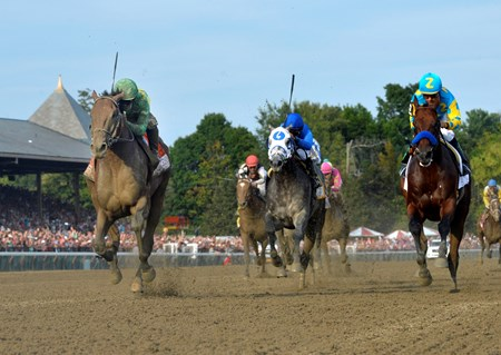 Keen Ice with jockey Javier Castellano, left overtakes American Pharoah with jockey Victor Espinoza to win the 146th running of the Travers Stakes Saturday evening Aug. 29, 2015 at the Saratoga Race Course in Saratoga Springs, N.Y.