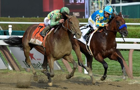 #7 Keen Ice with jockey Javier Castellano, overtakes American Pharoah with jockey Victor Espinoza to win the 146th running of the Travers Stakes Saturday evening Aug. 29, 2015 at the Saratoga Race Course in Saratoga Springs, N.Y.