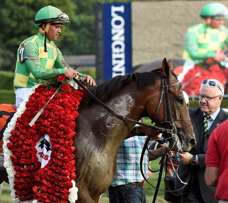 Keen Ice with jockey Javier Castellano, is given the winner's blanket after winning the 146th running of the Travers Stakes Saturday evening Aug. 29, 2015 at the Saratoga Race Course in Saratoga Springs, N.Y.