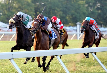 Mrs. P. K. Cooper's Photo Call grabbed the lead coming off the turn and repelled the late run of Cushion to tally her first stakes win in the $100,000 Violet Stakes (gr. IIIT) at Monmouth Park.
