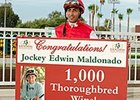 Edwin Maldonado celebrates win number 1,000.