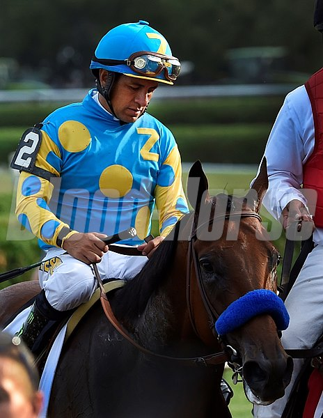 Victor Espinoza sits dejected atop American Pharoah after placing second in the 146th running of the Travers Stakes Saturday evening Aug. 29, 2015 at the Saratoga Race Course in Saratoga Springs, N.Y.