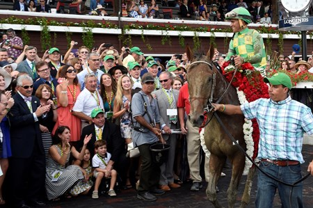 #7 Keen Ice with jockey Javier Castellano, is circulated in the winner's circle after winning the 146th running of the Travers Stakes Saturday evening Aug. 29, 2015 at the Saratoga Race Course in Saratoga Springs, N.Y.