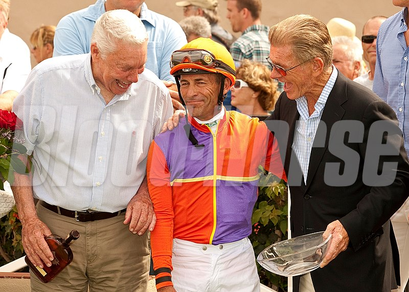After Beholder and Gary Stevens win the $100,000 Torrey Pines Stakes Sunday, September 1, 2013 at Del Mar Thoroughbred Club, Del Mar, CA, her owner B. Wayne Hughes, jockey Gary Stevens and Del Mar President Joe Harper celebrate victory.  © Benoit Photo