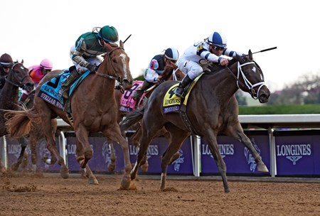 Stopchargingmaria held off Stellar Wind by a neck and withstood a review by the stewards to score a close victory in the $2 million Longines Breeders' Cup Distaff (gr. I) Oct. 30 at Keeneland.