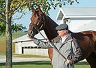 Beholder and trainer Richard Mandella at Keeneland Oct. 21.