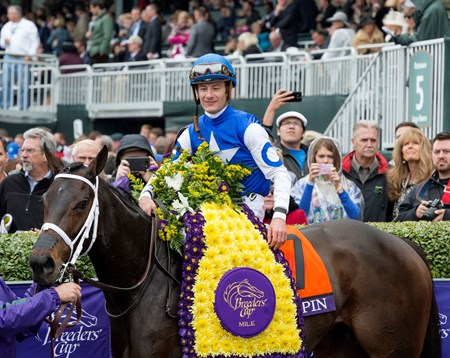 Jockey Julien Leparoux and Tepin are adorned with flowers.