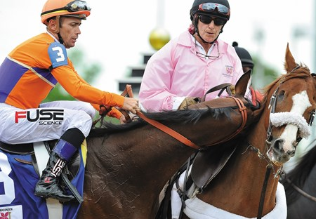 Garrett Gomez falls off of Beholder in the post parade for the 2013 Kentucky Oaks.