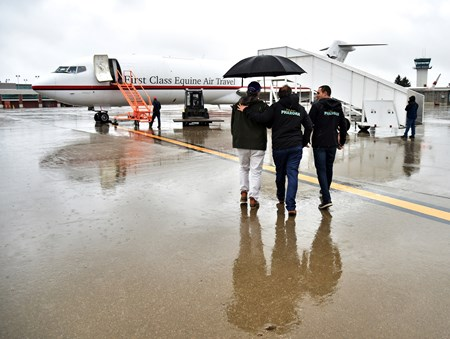 ( October 27, 2015) L-R Breeders' Cup President/CEO Craig Fravel, Ahmed and Justin Zayat, owners of Triple Crown winner American Pharoah, greet Pharoahs flight Tuesday afternoon at Bluegrass Airport in Lexington...