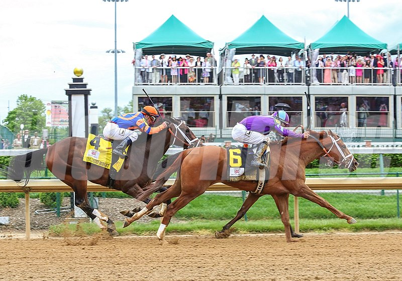 Princess of Sylmar and jockey Mike Smith roars past Beholder in the lane to win the Longines Kentucky Oaks (gr. I) May 3 at Churchill Downs. At 38-1, she's the second highest-priced winner in Oaks history. Photo by: Kevin Thompson