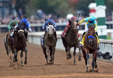 American Pharoah and jockey Victor Espinoza charge toward the finish in the Breeders' Cup Classic (gr. I).