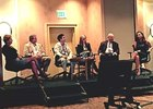 A panel discussing ownership at the International Simulcast Conference.