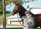 Beholder with trainer Richard Mandella.