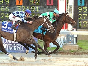 Exaggerator rebounded from a fourth-place finish in the Breeders' Cup Juvenile to capture the $1 million Delta Jackpot Stakes Nov. 21