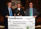 Chris Wittstruck receives the Stan Bergstein Writing Award from Team Valor CEO Barry Irwin, left, and media director Jeff Lowe.