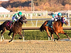 Gentlemen's Bet was declared the winner of the Frank J. De Francis Memorial Dash Stakes after the disqualification of Trouble Kid (right).