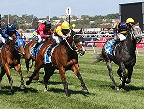 Delectation (left) comes home strong to win the Darley Classic.