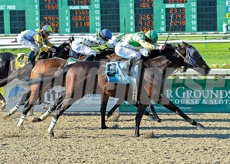 Call Me George gets up in the last stride to win the New Orleans Handicap (Grade II) at the Fair Grounds Race Course in New Orleans, LA, Saturday, March, 28, 2015. The win for jockey James Graham was his 2000th career win.