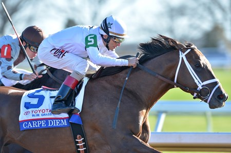 Carpe Diem and jockey John Velazquez win the Grade I Blue Grass Stakes at Keeneland on April 4, 2015. 