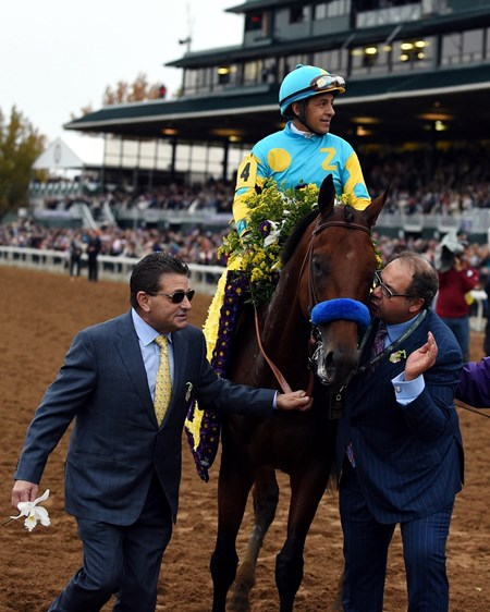 Owner Ahmed Zayat gives American Pharoah a kiss after this victory.