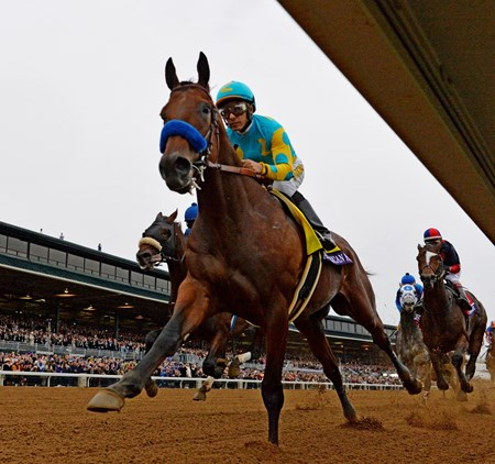 Jockey Victor aboard American Pharoah leads the field in front of the clubhouse for the first time in the Breeders' Cup Classic (gr. I).