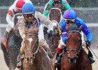 Discreetness (right) battles Synchrony (left) to win the Smarty Jones.