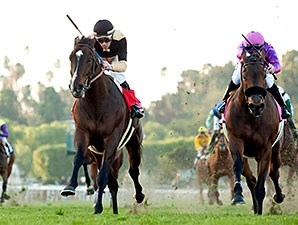 Flamboyant (left) catches Obviously to win the San Gabriel Stakes.