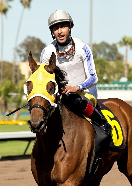 Jockey Edwin Maldonado guides San Onofre to the winner's circle after their victory in the Grade III, $100,000 Los Angeles Stakes, Saturday, April 16, 2017 at Los Alamitos Race Course, Cypress CA. © BENOIT PHOTO
