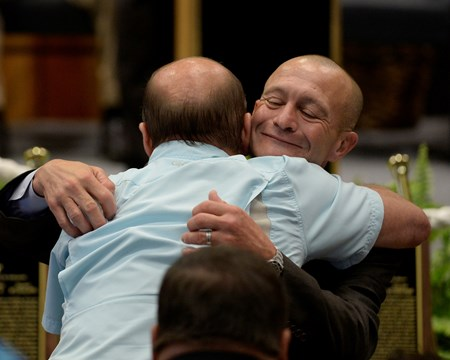Jockey Calvin Borel gets a hug from his brother Cecil Borel Aug. 9, 2013 during the National Museum and Racing Hall of Fame induction ceremony in Saratoga Springs, N.Y.       